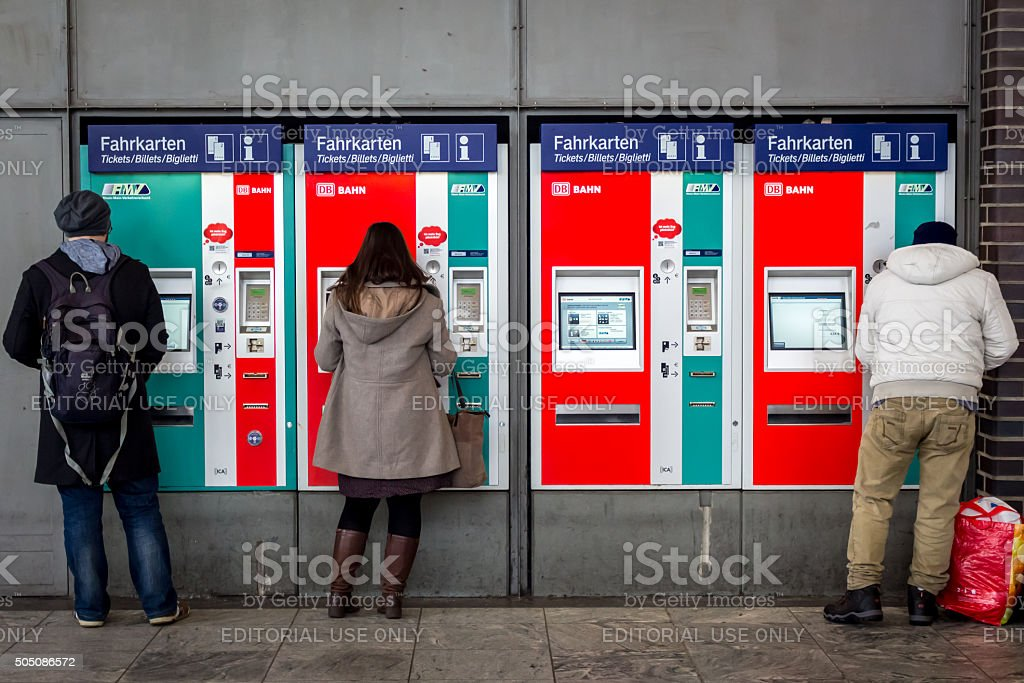 People Buying Tickets from DB Ticket Machine stock photo