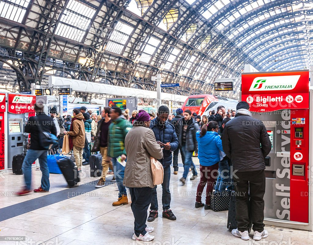 People buying tickets, Milano Centrale Train Station stock photo