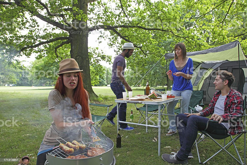 people camping with barbacue royalty-free stock photo