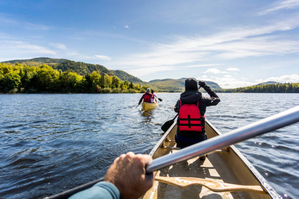 POV People Canoeing at Parc National du Mont-Tremblant, Quebec, Canada stock photo