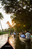 Kerala Backwaters, India - March 13, 2015. People canoeing on the Kerala Backwaters of Kerala, India.