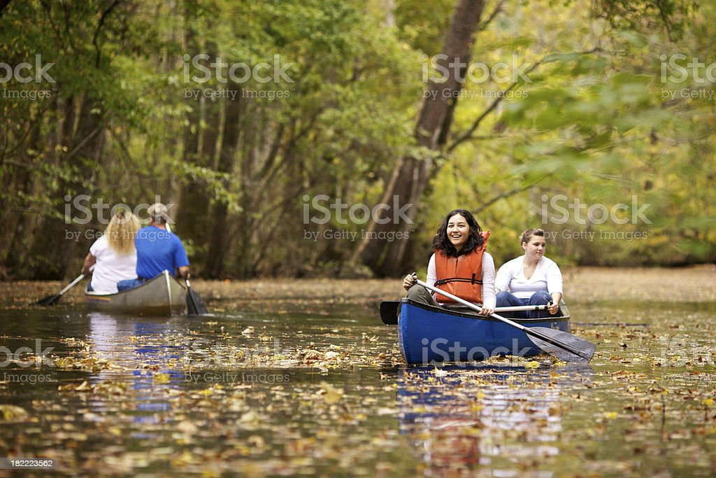 people canoeing royalty-free stock photo