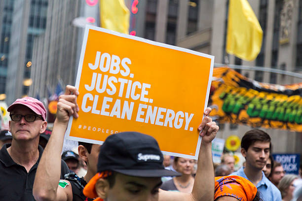 People carry placards during the People's Climate March, NYC stock photo