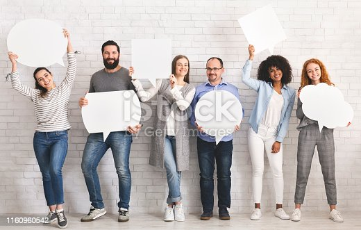 istock People carryng speech bubble icons at studio 1160960542