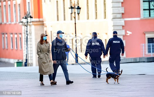 Castle Squere, Warsaw, Poland - 18 April 2020 - people in the old town (state of epidemic in Poland)