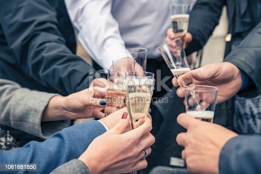 istock People celebrating a happy event clinking glasses of champagne,hands and glasses closeup. 1061681850