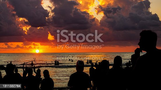 istock People celebrating at the beach of Costa Rica while the sun is setting down 1311332764
