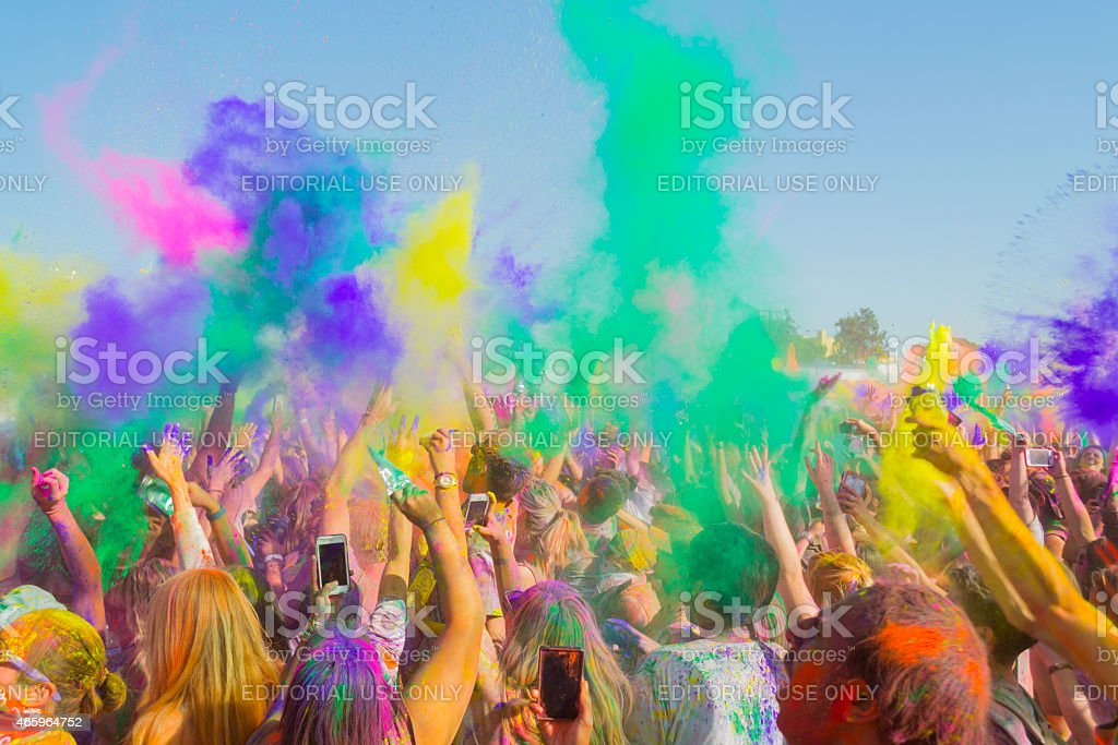 People celebrating during the color throw stock photo