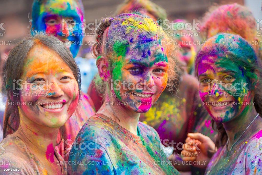 People Celebrating Holi Festival of Colors in Kathmandu Nepal stock photo