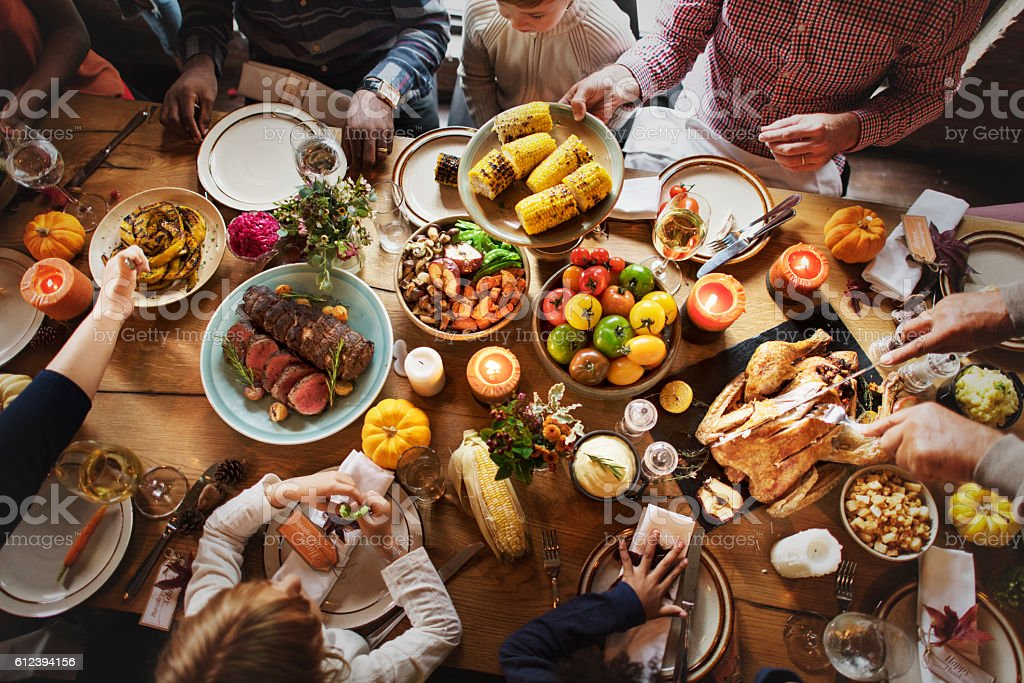 People Celebrating Thanksgiving Holiday Tradition Concept stock photo