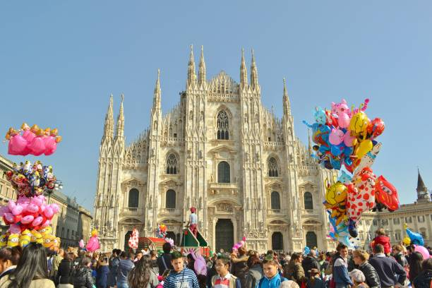 People celebrating the Carnival event at the Duomo square in Milan. stock photo