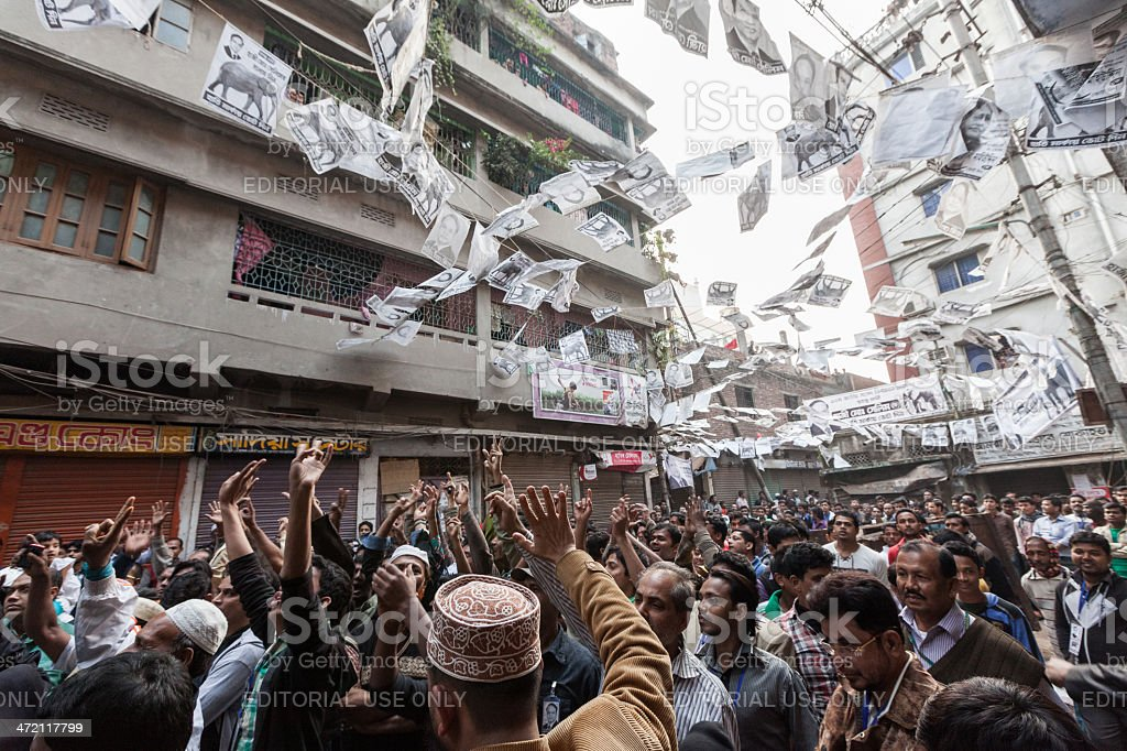 People celebrating while awaits the outcome of election in Bangladesh stock photo