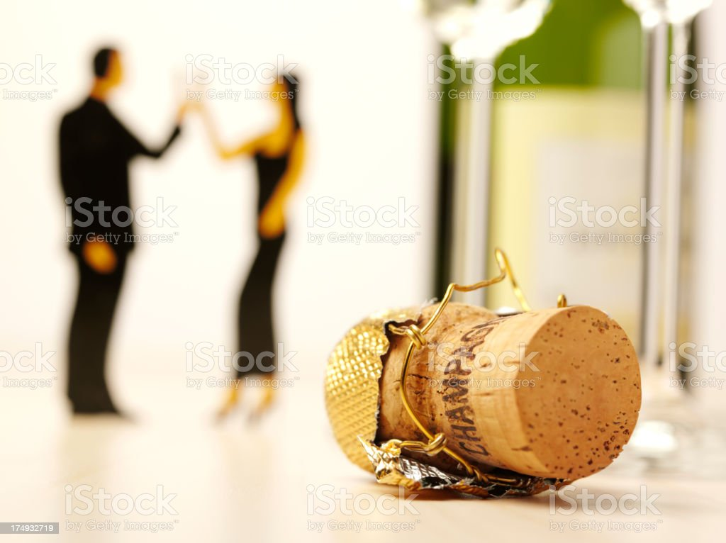 People Celebrating with Champagne and a Bottle Cork royalty-free stock photo
