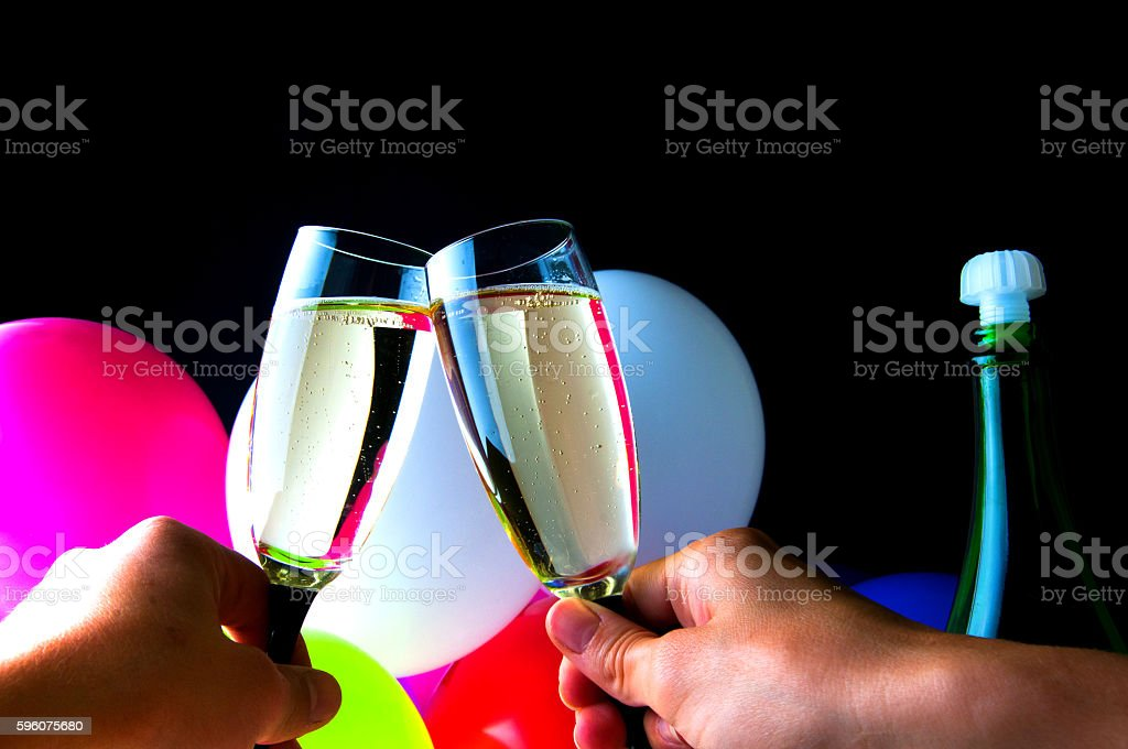 People celebrating with glass of champagne in their hands royalty-free stock photo