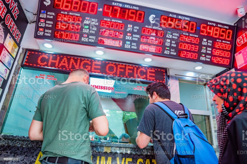people change currency at money changer shop royalty-free stock photo