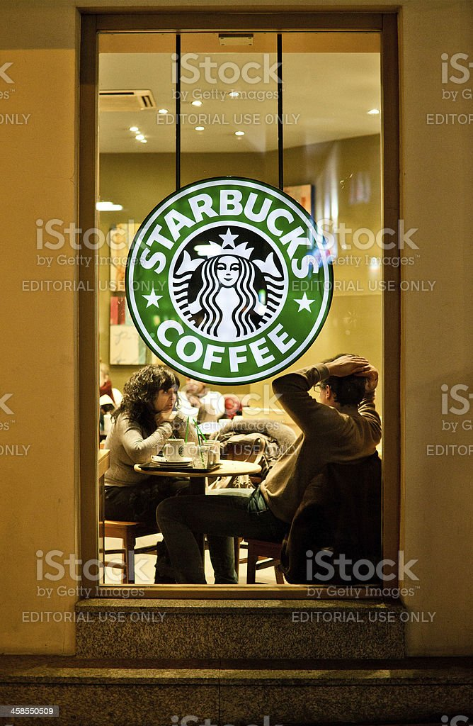 People Chatting at Starbucks Coffee royalty-free stock photo