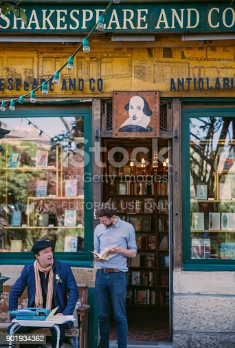 istock People Chatting out of a Bookstore in Paris 901934362