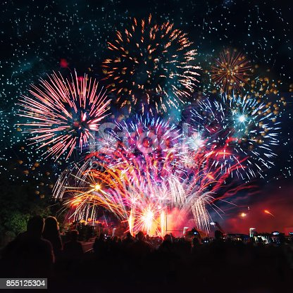 istock people cheering in front of vibrant firework 855125304