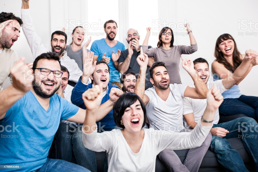 People cheering stock photo