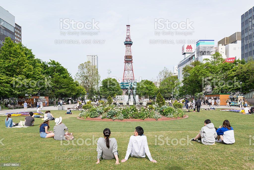People chilled out at Odori park, Sapporo, Hokkaido, Japan royalty-free stock photo
