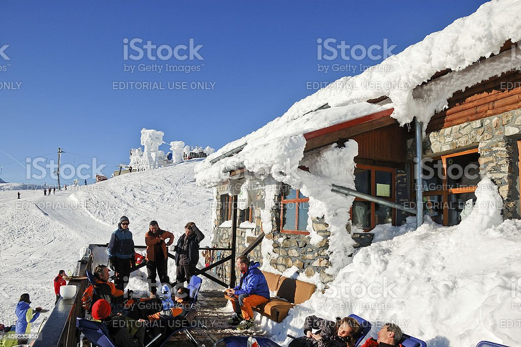 People chilling at mountain hut royalty-free stock photo