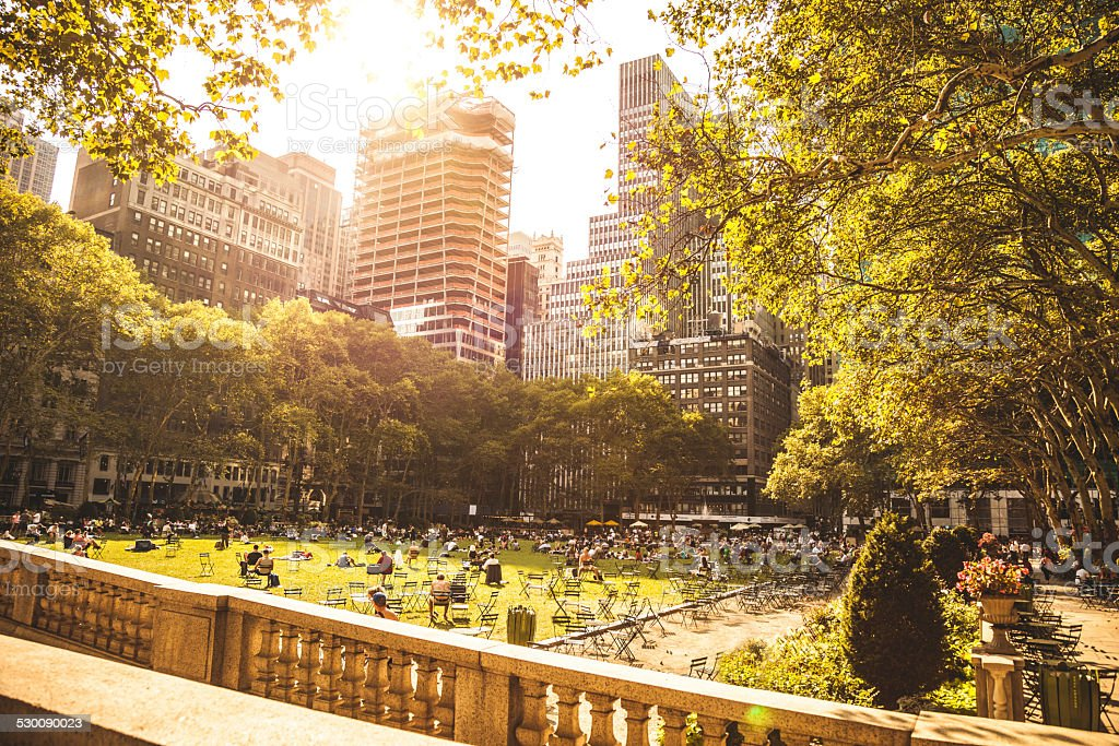 People chilling in Bryant Park, New York stock photo