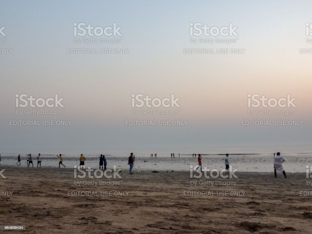 People chilling out at the beach royalty-free stock photo