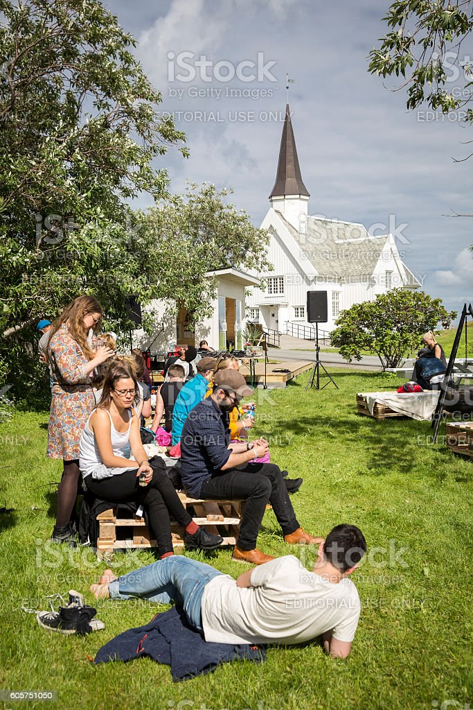 people chilling out having a drink during Traenafestival stock photo
