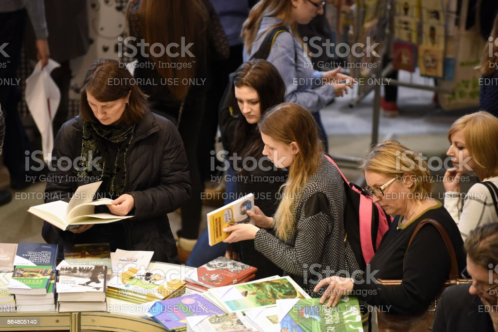 People choose books at the indoor book market stock photo