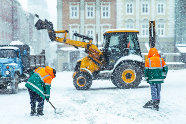 people cleaning city streets after snowstorm stock photo