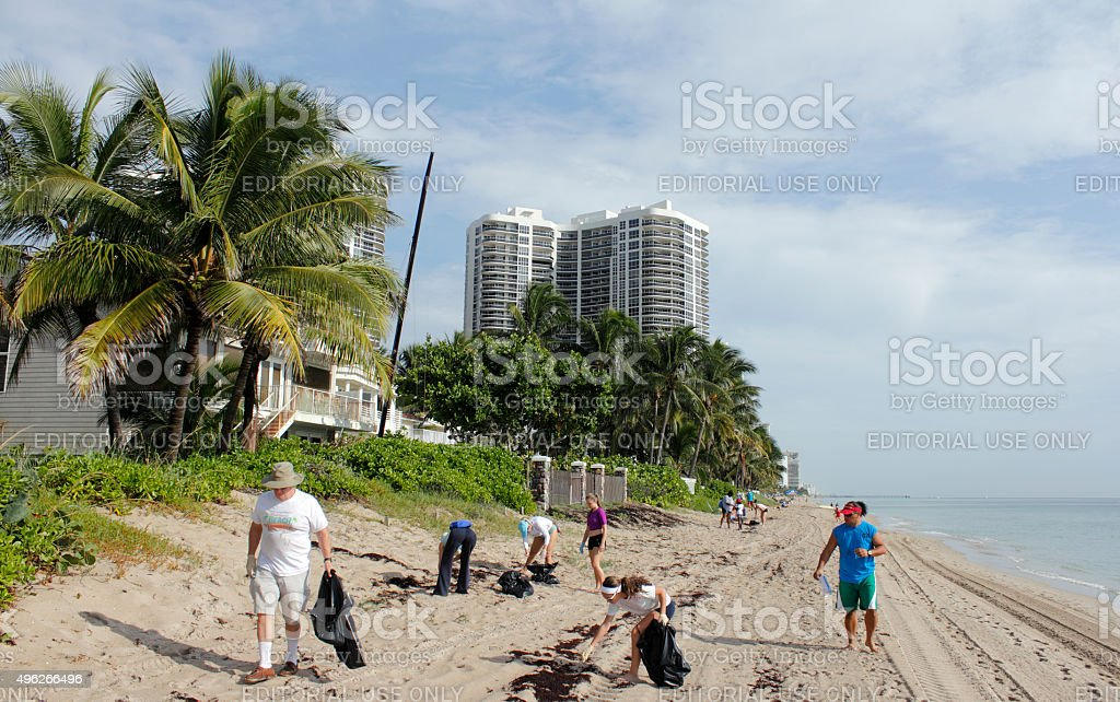 People Cleaning Up the Beach stock photo