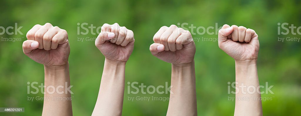 People Clenching Fists stock photo