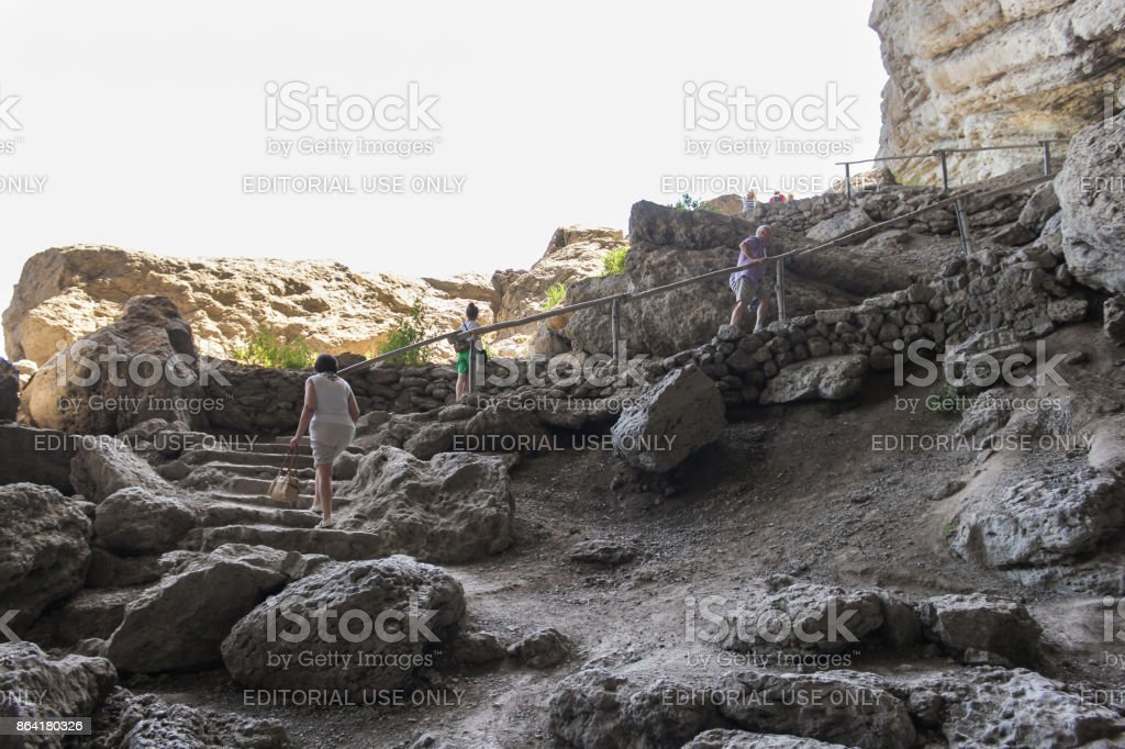 People climb the stone stairs. royalty-free stock photo
