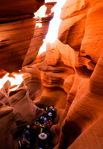 people climbing into antelope canyon - lower antelope canyon stock photos and pictures