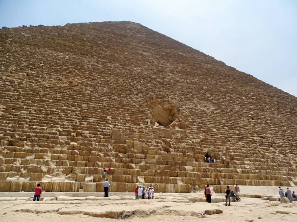 People climbing on the great Pyramid in Egypt stock photo
