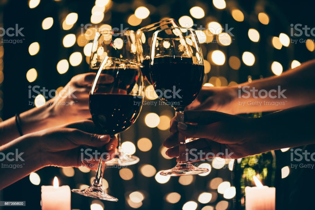 people clinking glasses with wine stock photo