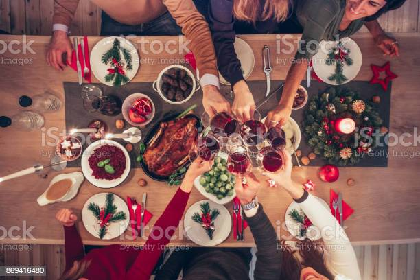 People clinking wine glasses at christmas table picture id869416480?b=1&k=6&m=869416480&s=612x612&h=pucylm uwdirepbtp29s8mryhmmxgoqunnwas wrwj4=