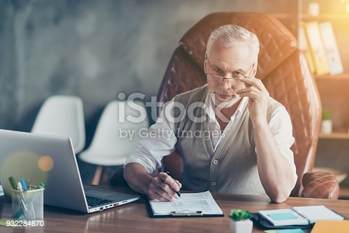 istock People collar executive corporate company owner luxury rich wealthy person workplace recruiter concept. Portrait of smart intelligent handsome entrepreneur holding pen signing partnership contract 932284670