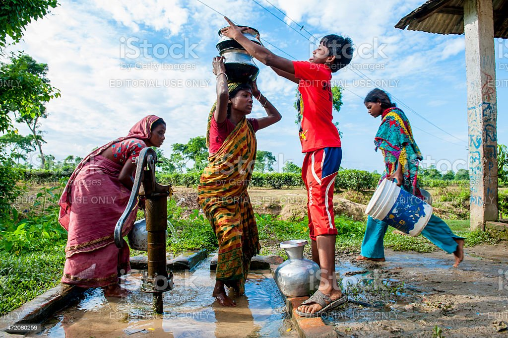 People collecting water from well in small village, Bangladesh stock photo