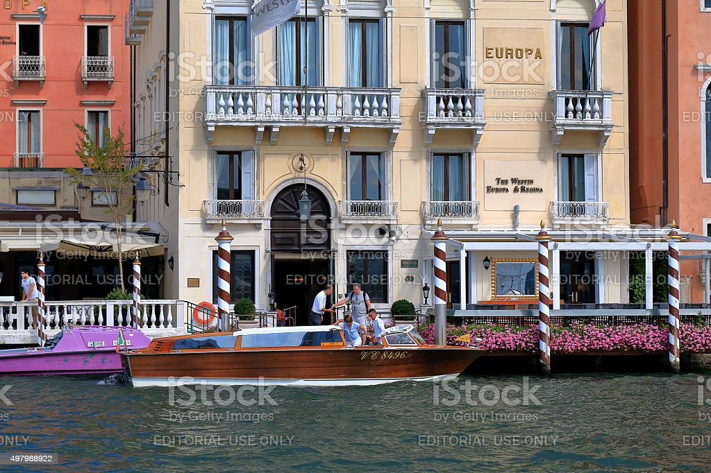 People come out of the hotel in Venice, Italy stock photo