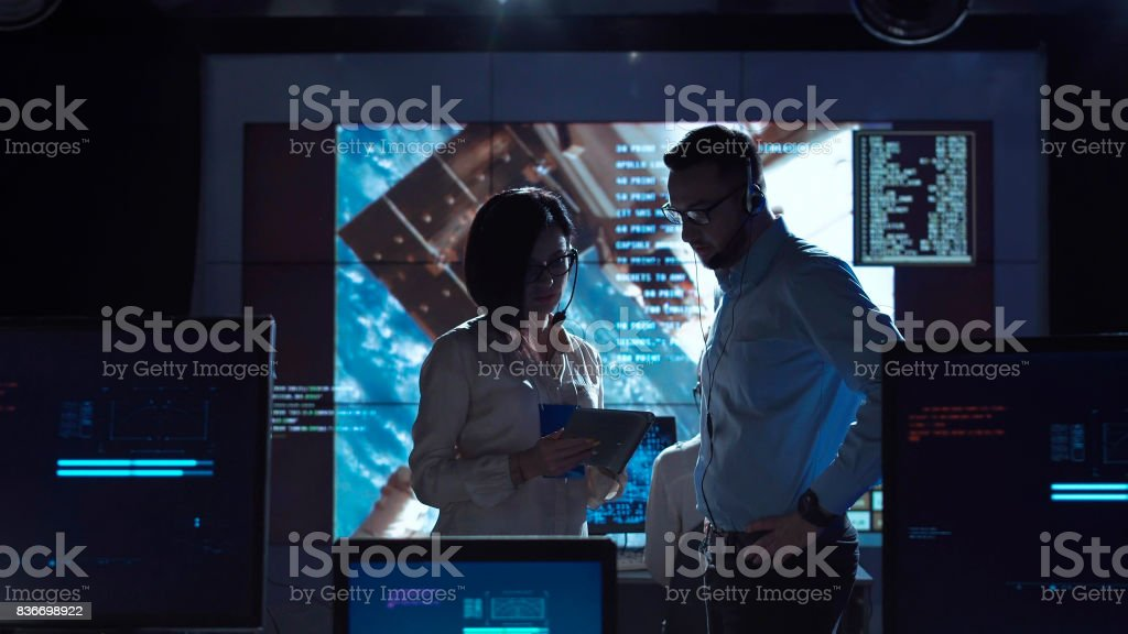 People communicating in space flight center stock photo