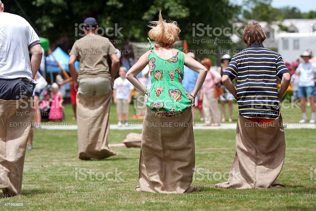 People Compete In Sack Race At Spring Festival stock photo