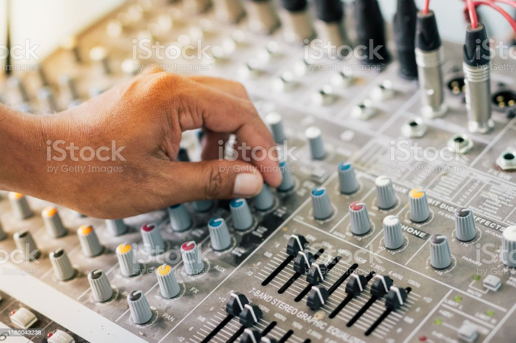 People controlling the sound, blurred scenes