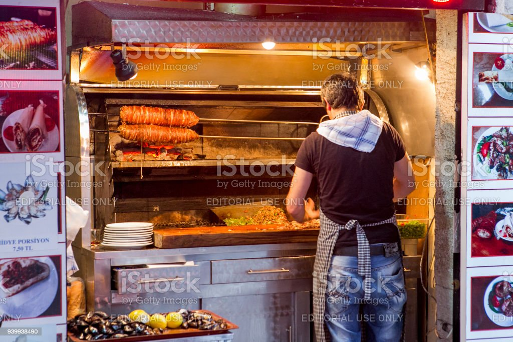 People cook traditional animal intestine kokorec fastfood at galata istanbul turkey stock photo