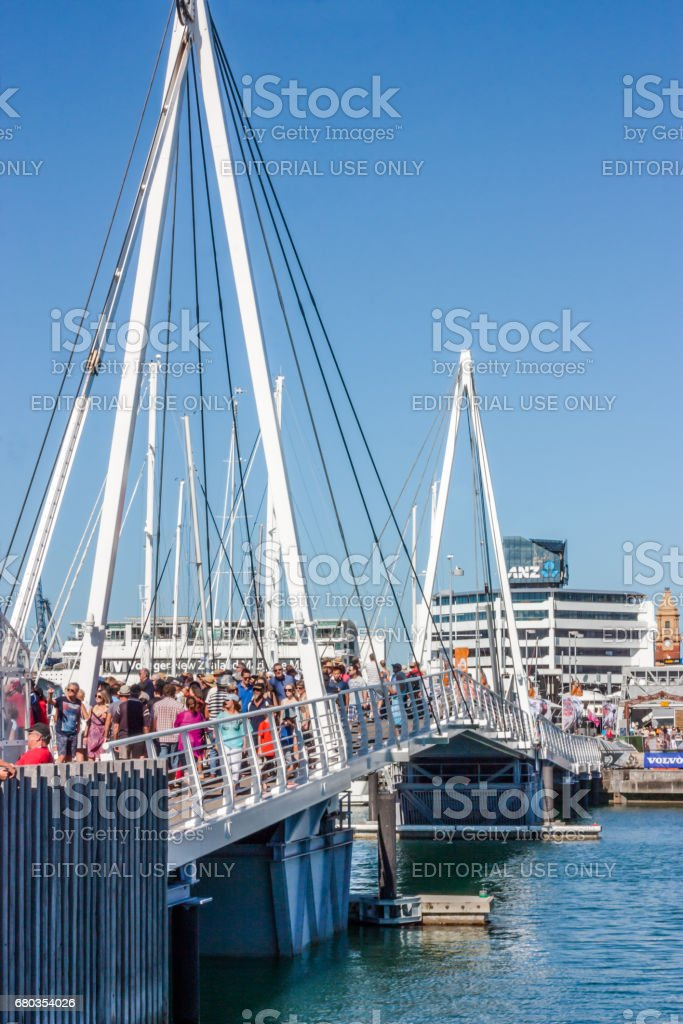 Auckland, New Zealand - March 01, 2015: People cross the bridge that links the Wynyard district to the Viaduct Marina in Auckland, New Zealand. royalty-free stock photo