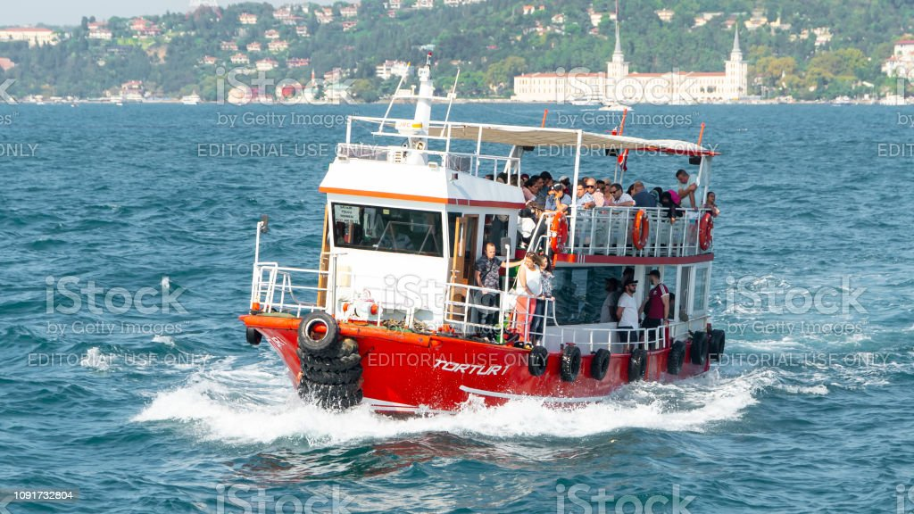 People crossing Bosphorus strait on a small passenger boat in Istanbul, Turkey stock photo