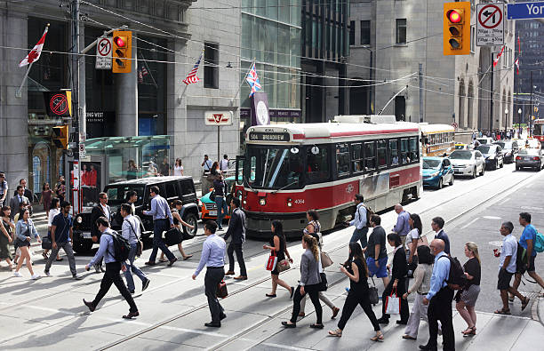 People Crossing King Street at Yonge, Downtown Toronto, Ontario, Canada stock photo