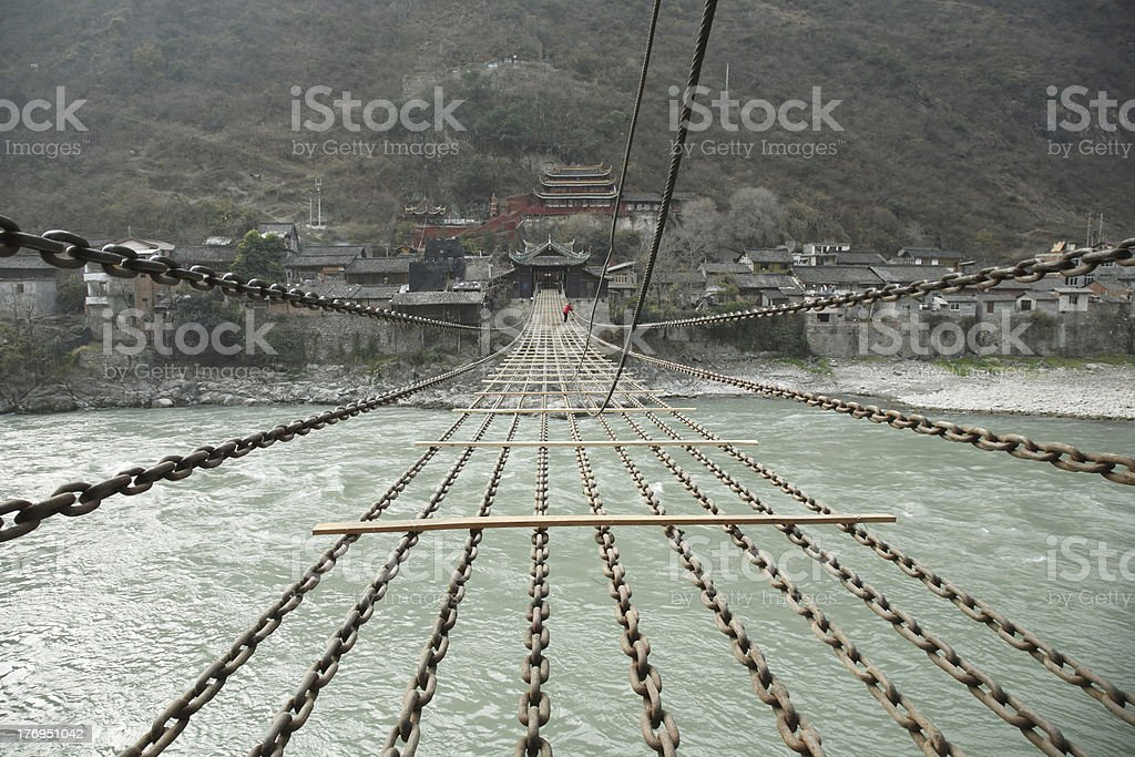 People crossing Luding bridge without plank royalty-free stock photo
