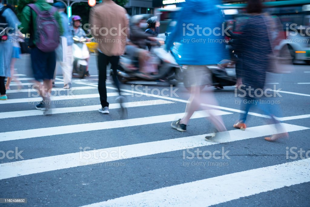People crossing street in asia, motion blur