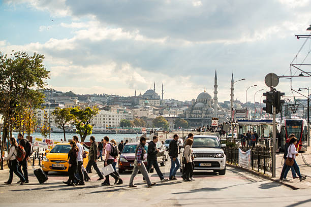 people crossing street in istanbul - eminonu district stockfoto's en -beelden